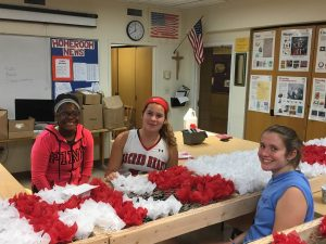 Students help decorate the float for the Columbus Day Parade.
